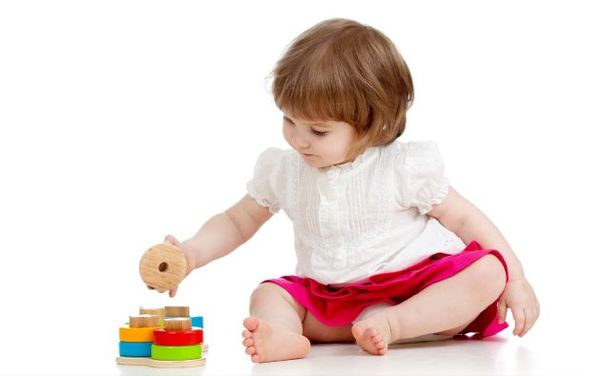 a toddler playing with learning blocks