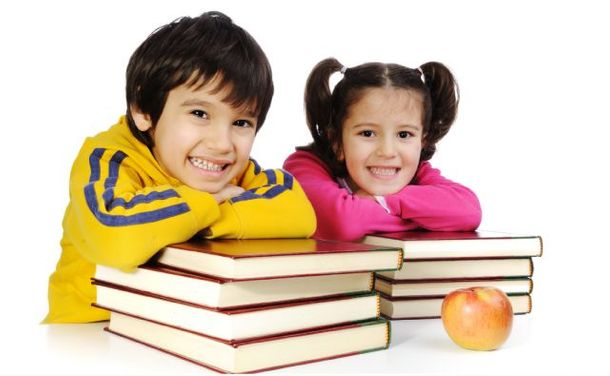 little boy and little girl with books and an apple